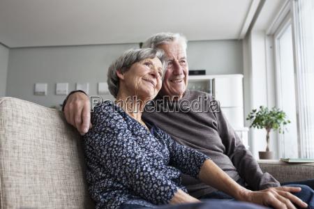 happy senior couple sitting together on