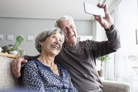 laughing senior couple sitting on the