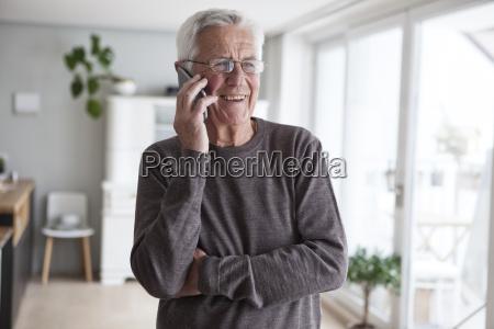 portrait of smiling senior man telephoning