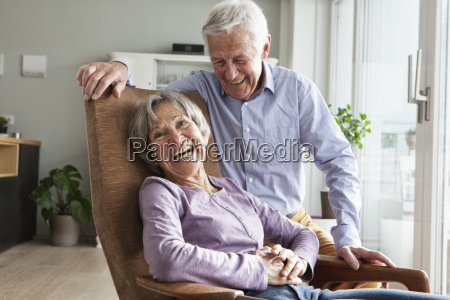 laughing senior couple at home