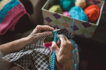 hands of knitting senior woman close