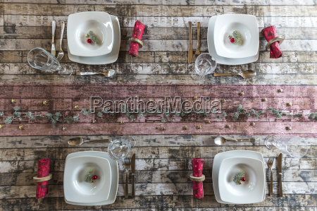 four place settings on laid table