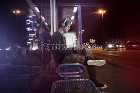 germany munich man with headphones sitting