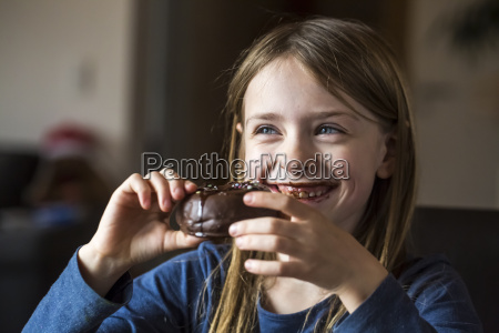 portrait of smiling girl eating chocolate
