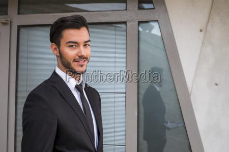 portrait of smiling businessman wearing black