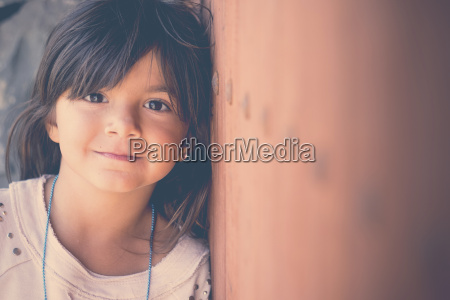 portrait of smiling girl leaning against