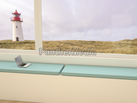 windowsill with laptop looking through window