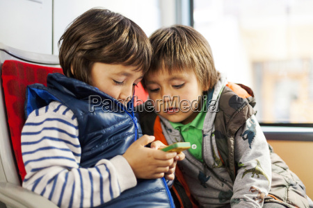 two little boys sitting in a