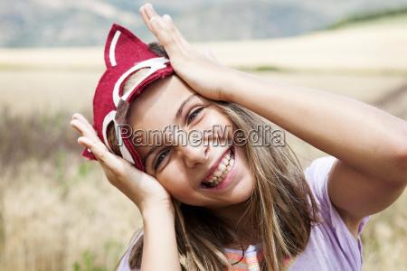portrait of happy girl with animal