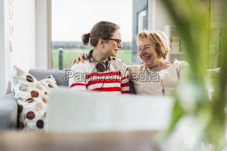 senior woman smiling at young woman