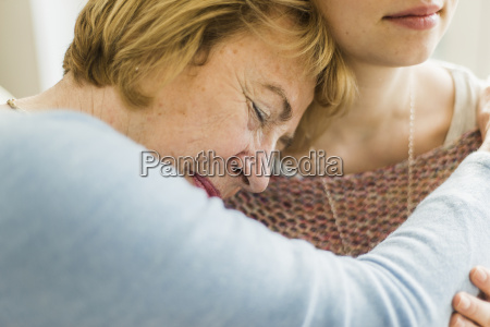 senior woman with closed eyes leaning