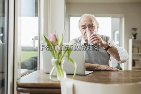 portrait of senior man with laptop
