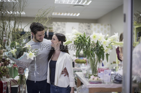 happy young couple with bunch of