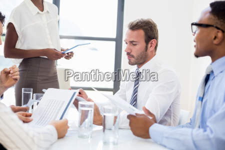 business colleagues discussing in meeting