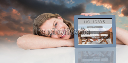 composite image of woman showing tablet