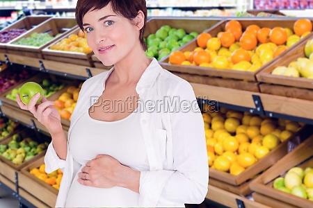 composite image of portrait of pregnant
