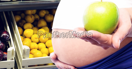 composite image of pregnant woman holding
