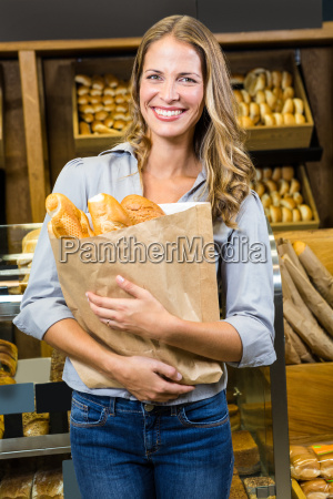 portrait of woman holding paper bag