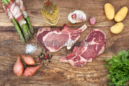 chops raw with spices and vegetables