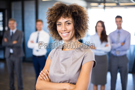 businesswoman smiling at camera while her