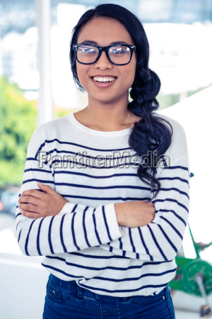 smiling asian woman with arms crossed