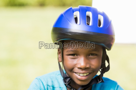 young boy wearing his helmet