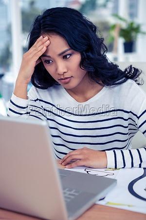 pretty woman looking at computer monitor