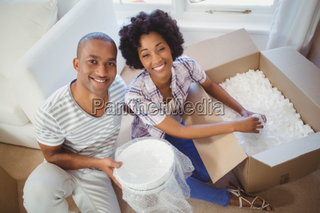 happy couple opening boxes