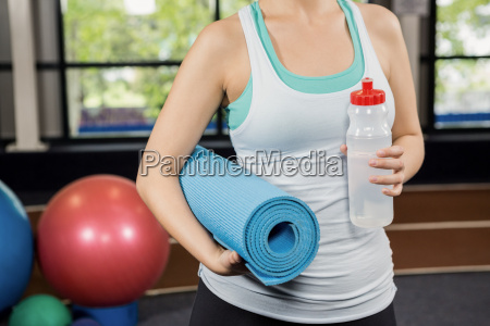 mid section of woman holding exercise