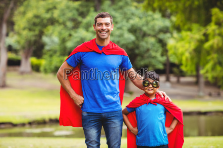 father and son in superhero costume