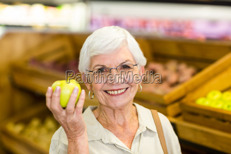 senior woman holding and watching a