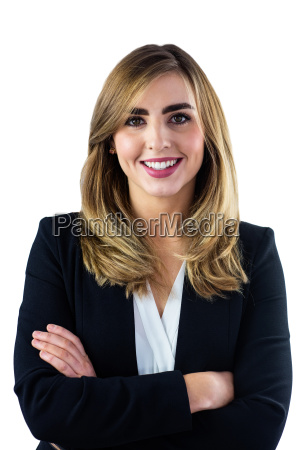 smiling woman with arms crossed looking