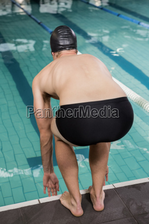 swimmer about to dive into the