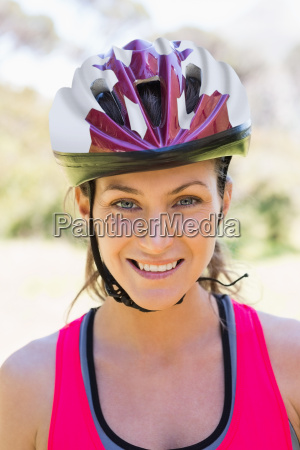 fit smiling woman wearing helmet