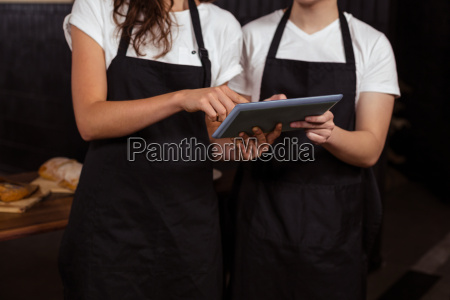 co workers using tablet