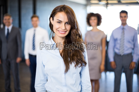 businesswoman smiling at camera while his