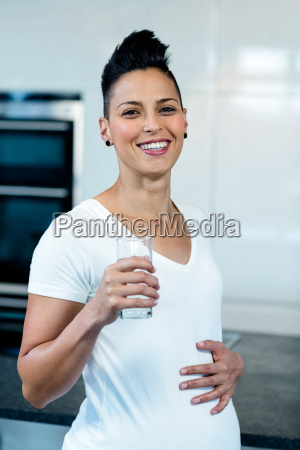 portrait of pregnant woman drinking water