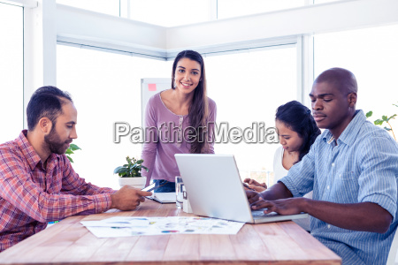 portrait of smiling businesswoman with coworkers