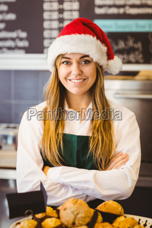 cute waitress standing behind the counter