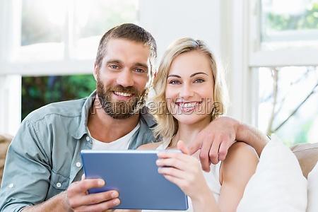 portrait of couple sitting on sofa