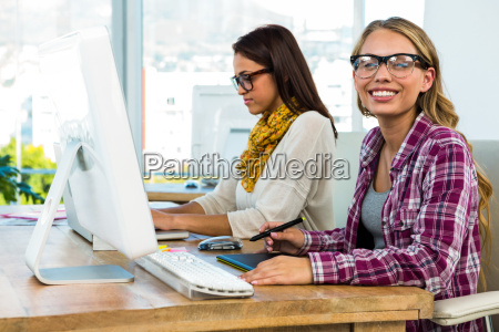 two girls work at office