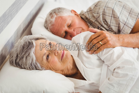 senior woman awake on bed