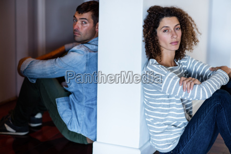 portrait of couple sitting on opposite