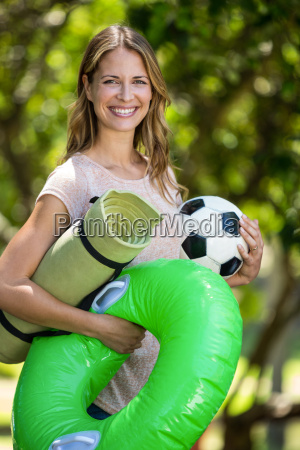 smiling woman holding different things