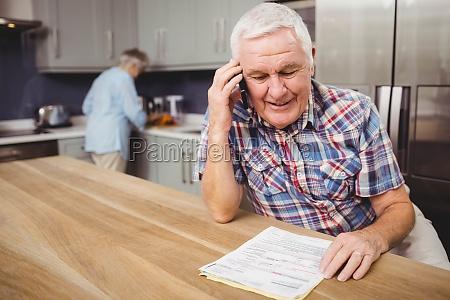 senior man talking on phone and