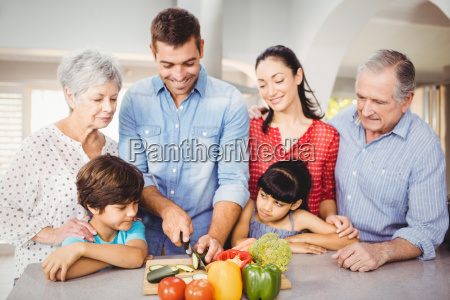happy man with family by kitchen