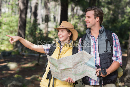 woman pointing away with partner during