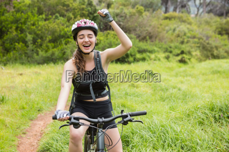 smiling woman cycling