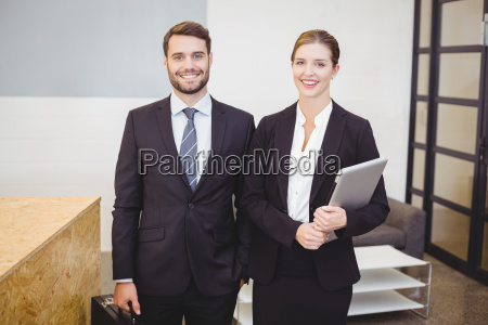 happy business people standing by counter