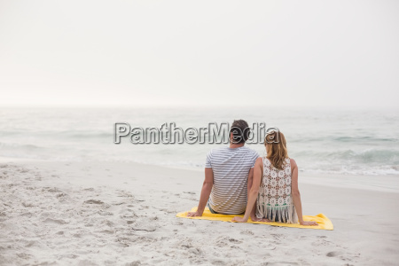 rear view of couple sitting on